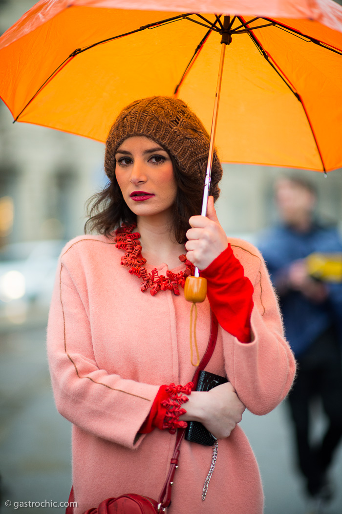 Pink Coat and Orange Umbrella, Outside Gucci